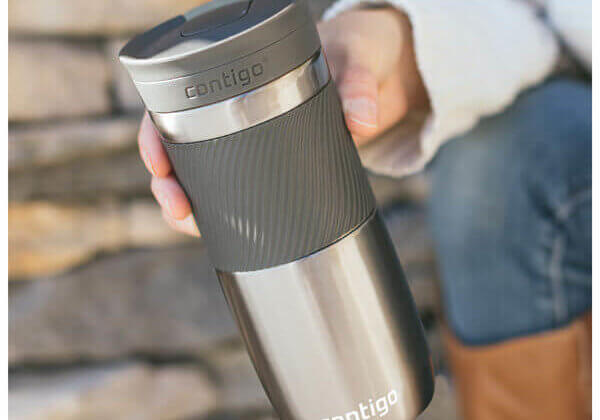 man holding travel mug