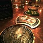 challenge coins on a bar