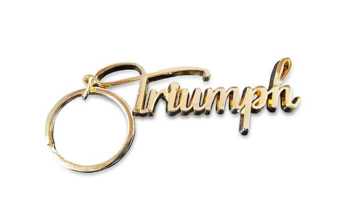 custom cast keychain triumph logo