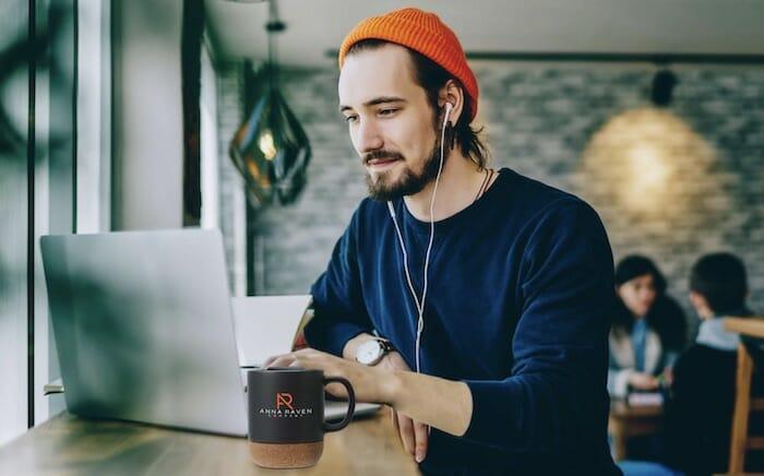 guy with custom mug on a desk