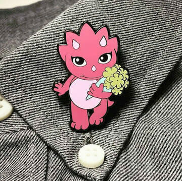 customized lapel pin of a pink cat
