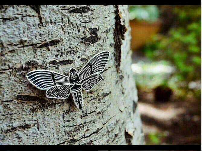 custom moth pin on tree