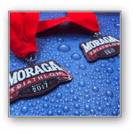 custom marathon medals with red ribbons