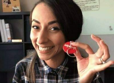 girl holding custom shaped keychain