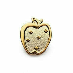 apple pin in gold metal