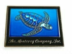 company pin with sea turtle