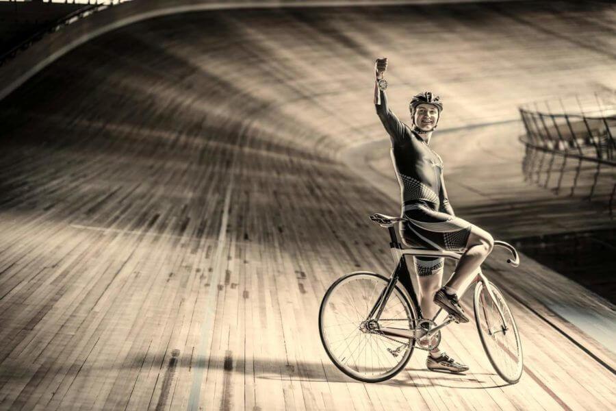 bike racer holding a meddlion