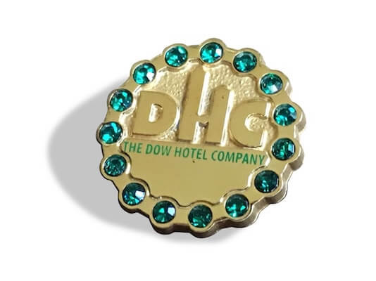 gold service pins with emeralds