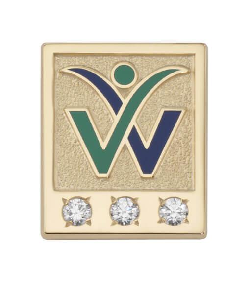 three diamonds on a gold pin