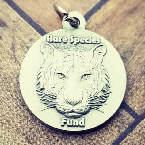 logo pendant with tiger